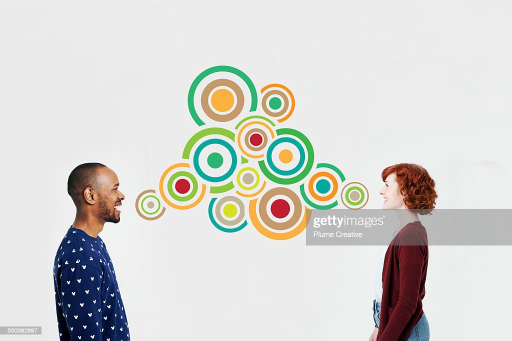 Man and woman with illustrated bubbles : Stock Photo