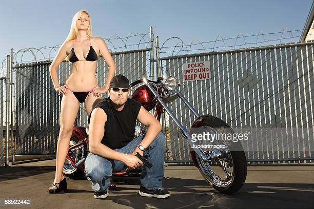 Man and woman with motorcycle