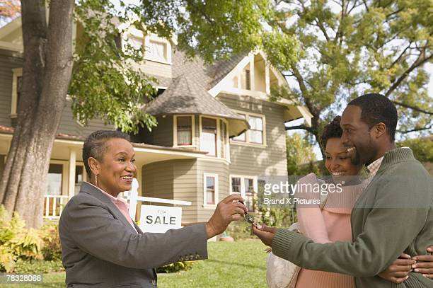 Man and woman with new house