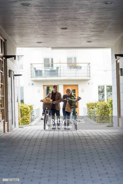 Man and woman with their bicycles after shopping