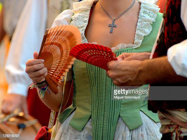Man and woman with traditional fan
