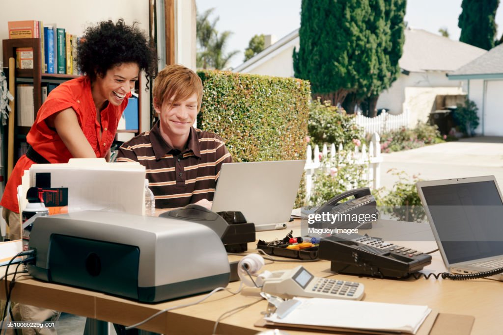 Man and woman working at desk in garage