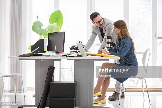Man and woman working together at modern office