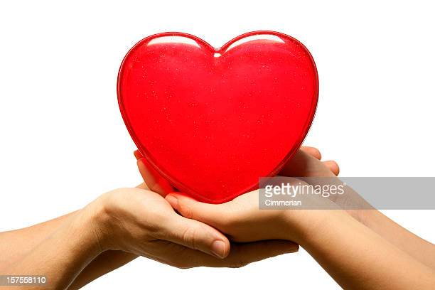 Man and woman's hands holding heart