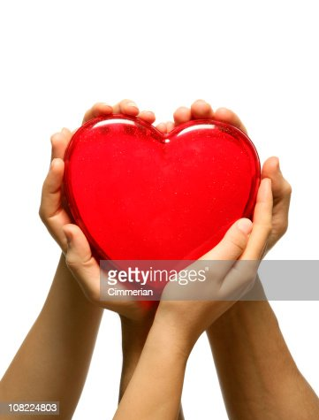 Man and Woman's Hands Holding Plastic Red Heart : Foto de stock