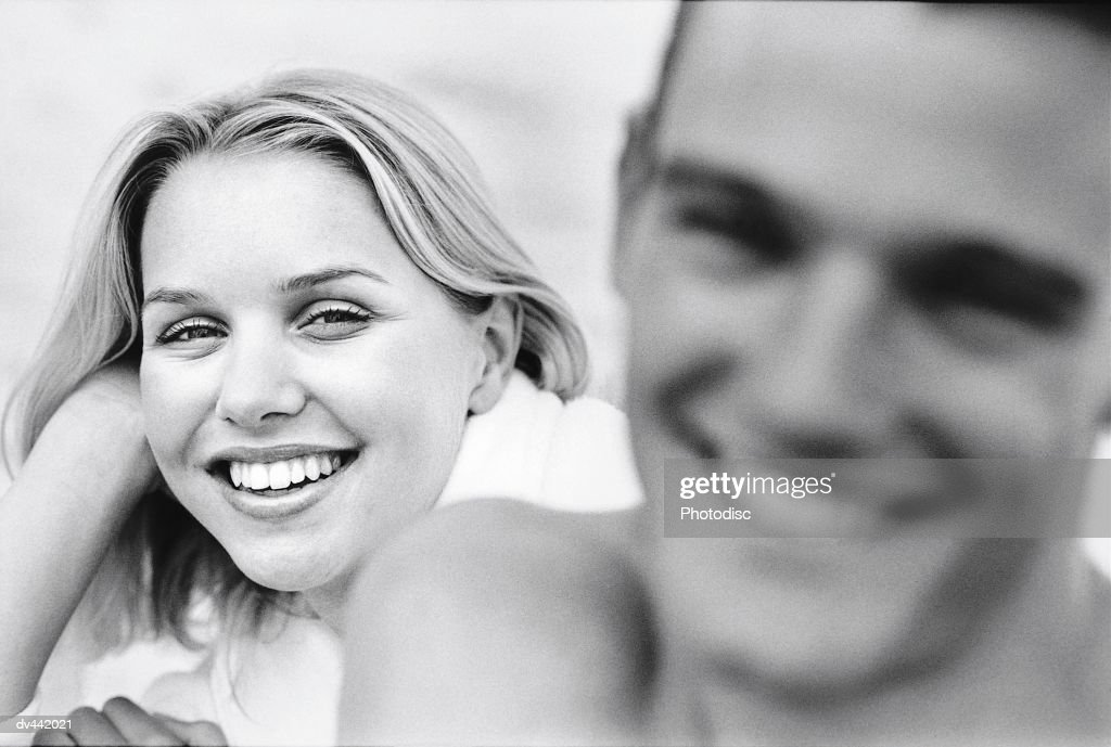 Man and woman's heads, woman in focus : Stock Photo