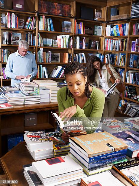 Man and women looking through books in bookstore
