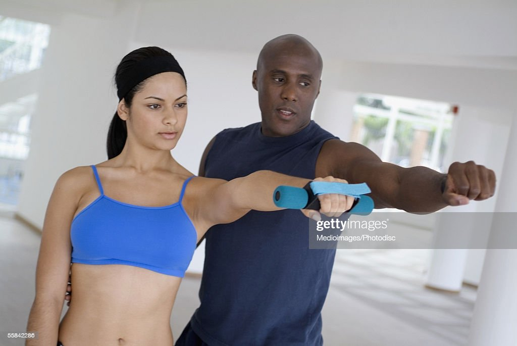 Man and young woman training side by side, tilt : Stock Photo