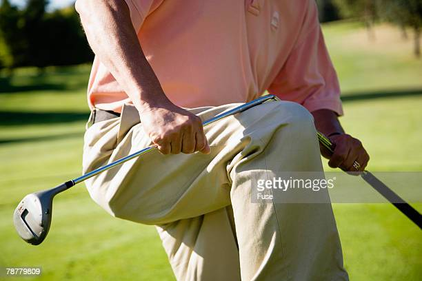 Man Angrily Breaking his Golf Club
