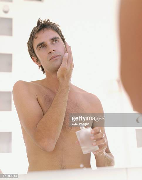 A man applying aftershave