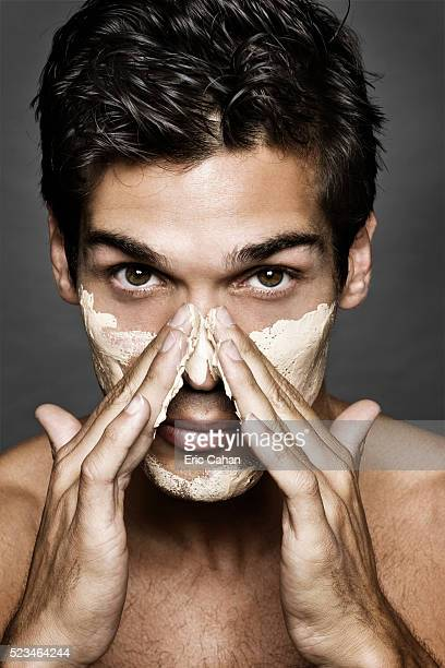 Man Applying Beauty Cream to Face