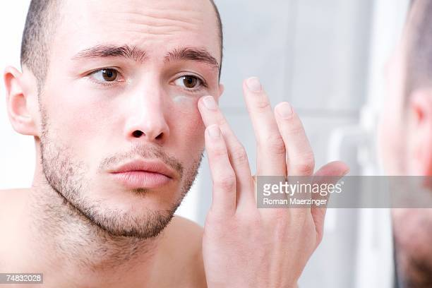 Man applying face cream, close-up