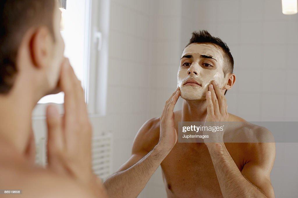 Man applying face mask : Stock Photo