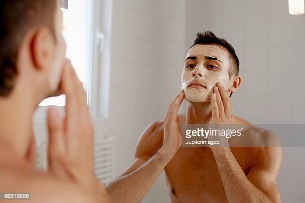 Man applying face mask