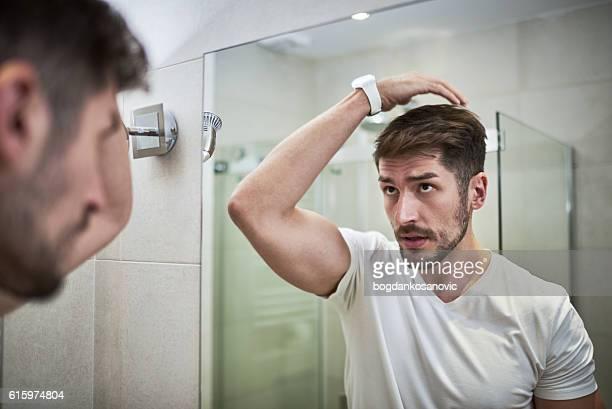 Man applying gel
