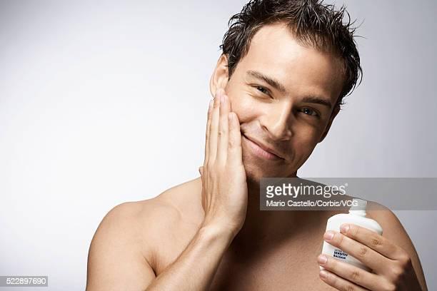 Man applying lotion