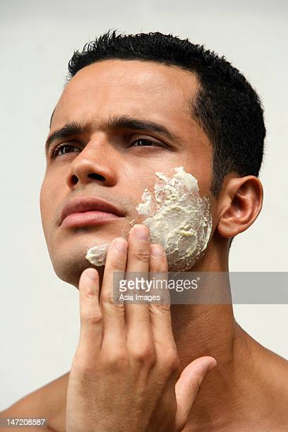 Man applying natural face scrub