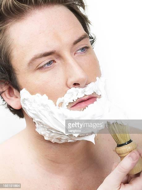 Man applying shaving cream