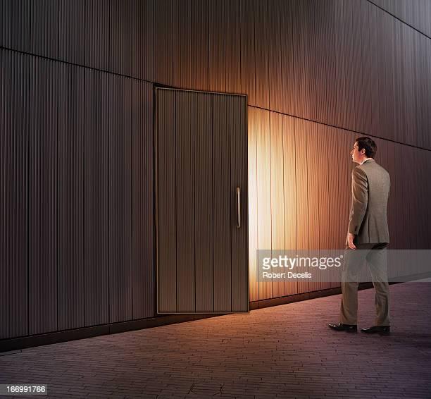 Man approaching slightly open external door