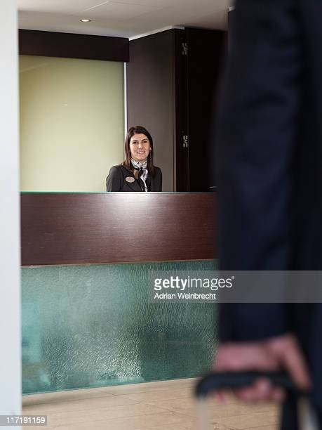 Man aproaching front desk of a hotel