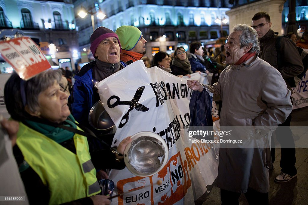 A man argues with protestors as they bang pans and shouting slogans during a demonstration against the proposed 'Eurovegas' project on February 8, 2013 in Madrid, Spain. Controversial plans have been given the go ahead for the Las Vegas Sands Corporation to build Europe's biggest casino and conference centre on the outskirts of Madrid bringing thousands of much needed jobs for the Spanish economy. As multi billionaire investor Sheldon Adelson's announced his plans protestors were claiming that the 36,000 room hotel complex would bring gambling addiction, criminal activity, prostitution and environmental damage to the area.
