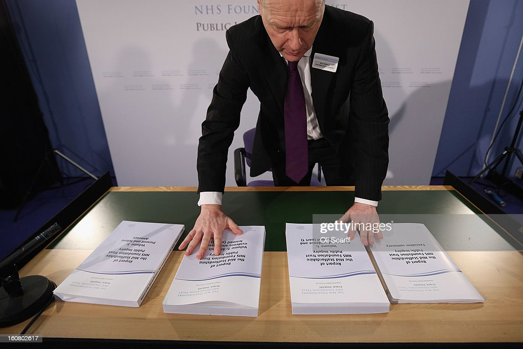 A man arranges a copy of the report compiled by Robert Francis QC of the Mid Staffordshire NHS Trust Foundation Public Inquiry on February 6, 2013 in London, England. The report examines the commissioning, supervisory and regulatory bodies in the monitoring of Mid Staffordshire hospital between January 2005 and March 2009. The report will be laid before Parliament at 11:30am today and will consider the reasons why serious problems at the Trust were not identified and rectified sooner, and identify lessons to be learnt for future patient care.
