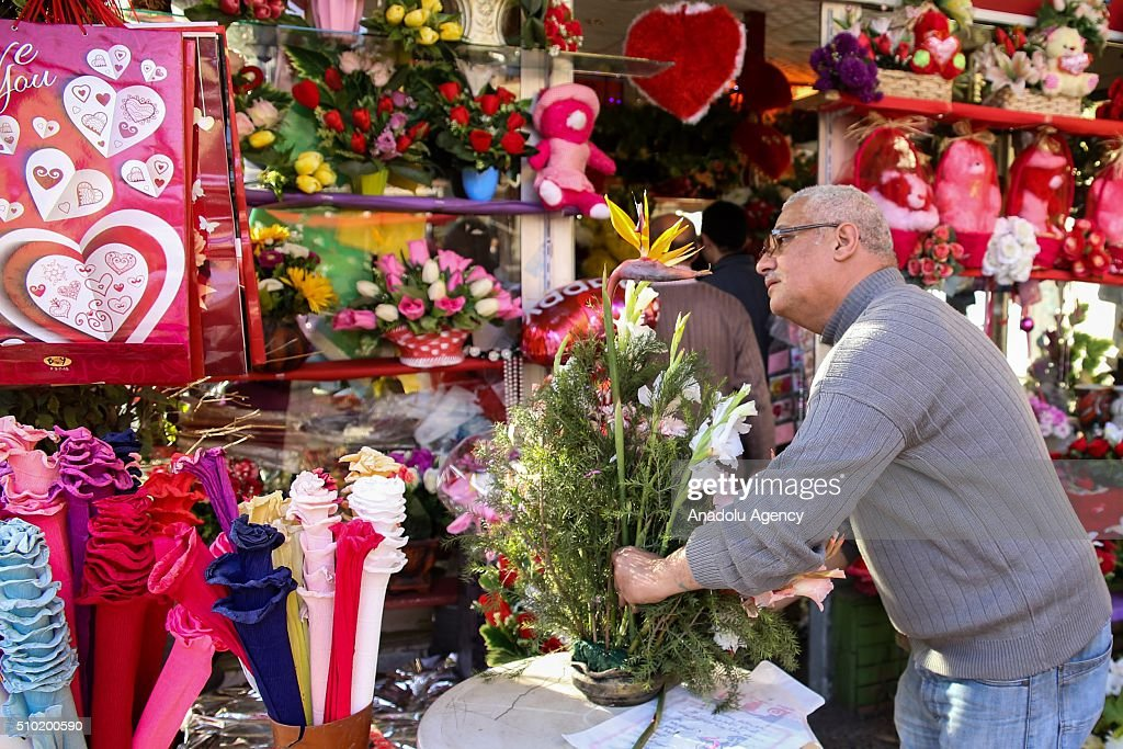 A man arranges flowers in his flower market during Valentine's Dayin Cairo, Egypt on February 14, 2016.