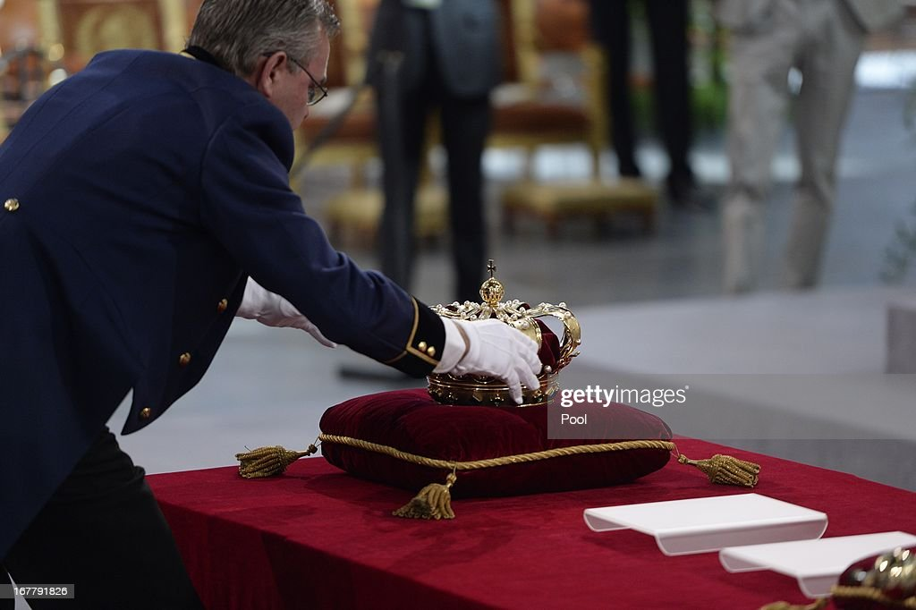 A man arranges the regalia (Crown, Sceptre, Globus Cruciger and Sword of State) at the credence-table prior to the inauguration of HM King Willem Alexander of the Netherlands at New Church on April 30, 2013 in Amsterdam, Netherlands.