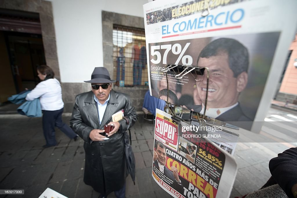 A man arrives at a newsstand in Quito a day after Ecuadorean President Rafael Correa was reelected as the country's leader, on February 18, 2013. Fresh from a landslide re-election victory, President Rafael Correa hoped Monday to match it with a sweeping legislative win needed to clear the way for deeper socialist changes in Ecuador. AFP PHOTO/RODRIGO BUENDIA