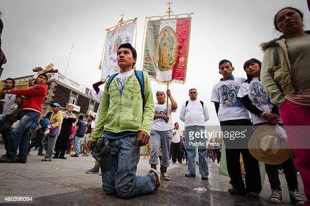 A man arrives Basilica of Our Lady of Guadalupe on his knees The Basilica of Our Lady of Guadalupe in Mexico City is one of most popular Marian...