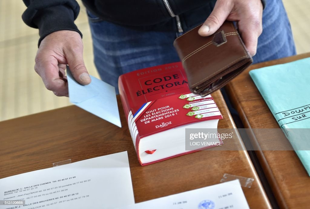 A man arrives to cast his vote on June 26, 2016 in Notre-Dame-des-Landes during a local referendum organised in Loire-Atlantique on subject of the Notre-Dame-des-Landes' airport project. Nearly One million people living in France's Loire-Atlantique department are voting in a referendum which poses the question 'Are you in favour of the project to transfer the Nantes-Atlantique airport to the municipality of de Notre-Dame-des-Landes?' to voters. The referendum was organised by the French executive power hoping to find a solution to the issue which has dragged on for 50 years. / AFP / LOIC