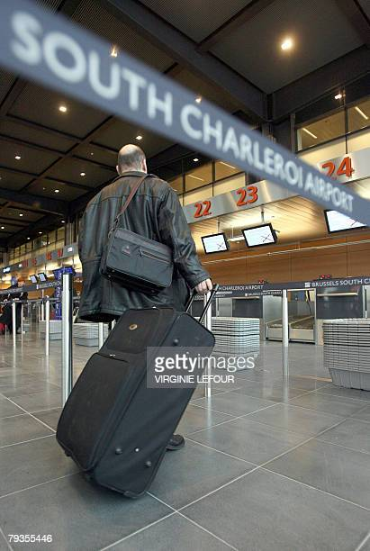 A man arrrives with his luggage 29 January 2008 at the new terminal of Charleroi airport in Gosselies on the day of its opening AFP PHOTO / BELGA...