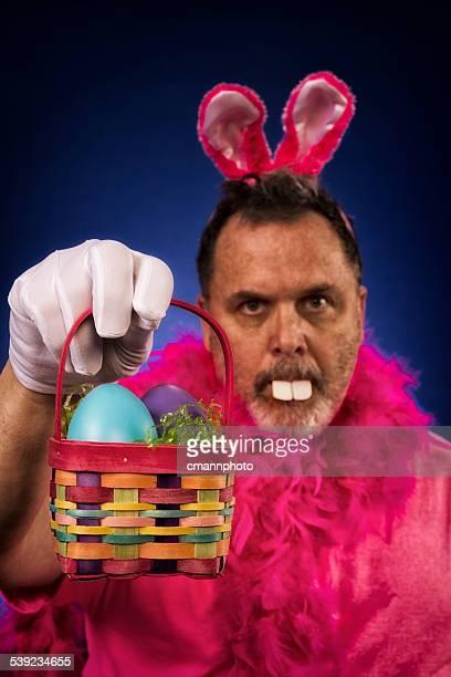 Man as Deranged Easter Bunny offering basket