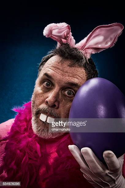 Man as Deranged Easter Bunny with a large egg