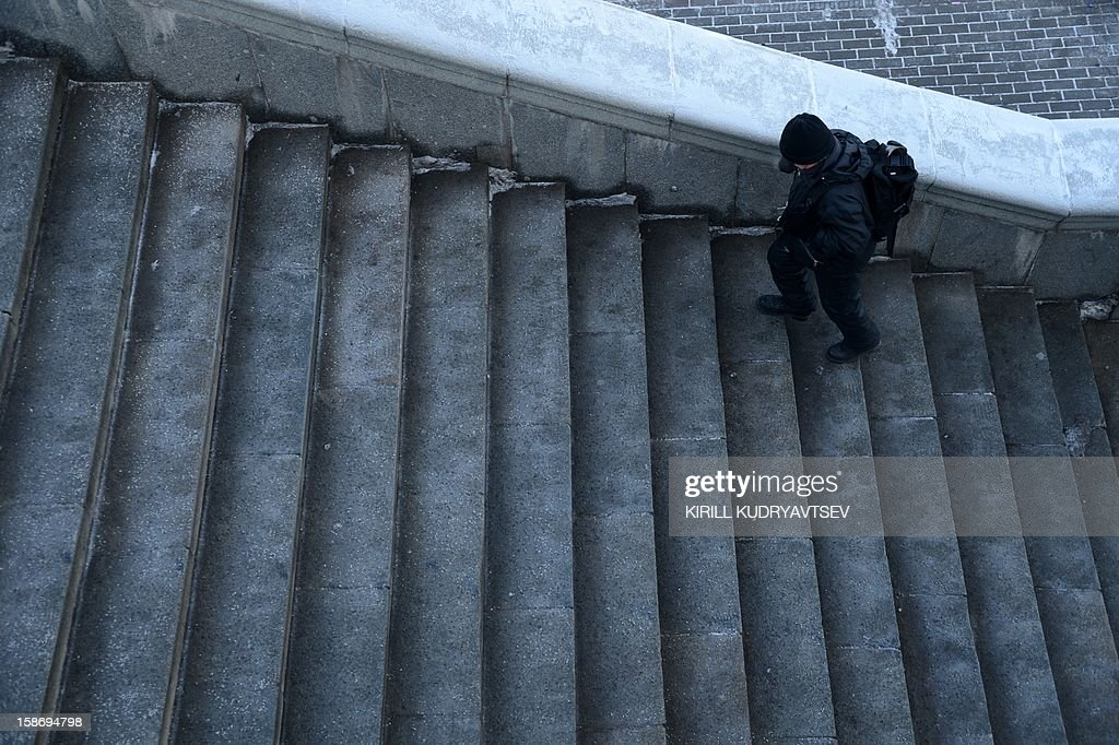 A man ascends the staircase of Krymsky Bridge in Moscow, on December 24, 2012.