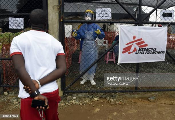 A man asks a health worker about his wife being treated at the medical centre of Doctor Without Borders Medecin sans Frontiere where people infected...