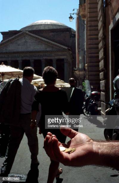 A man asks for alms near to the Pantheon on November 26 2005 in Rome Italy