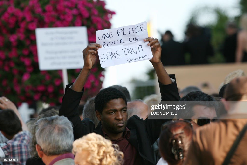 A man asks for invitations to enter the Palais des Festival, during the 63rd Cannes Film Festival on May 22, 2010 in Cannes.