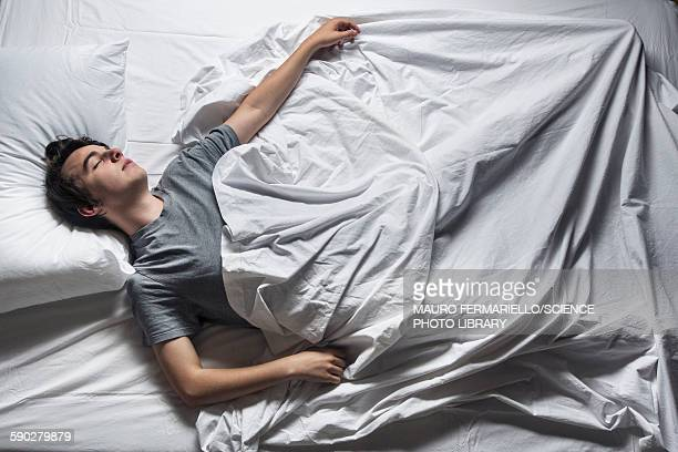 Man asleep in a bed