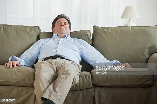 man asleep on couch