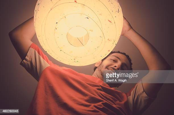 Man assembling a ceiling paper lamp shade