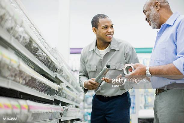 Man Assisting Customer in Hardware Store