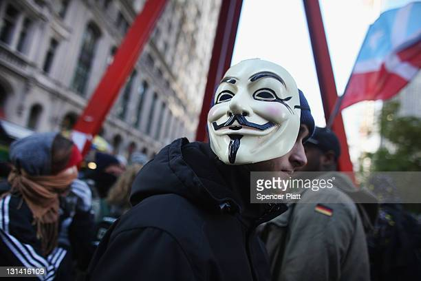 A man associated with the 'Occupy Wall Street' movement displays a mask in Zuccotti Park in the Financial District near Wall Street on November 4...