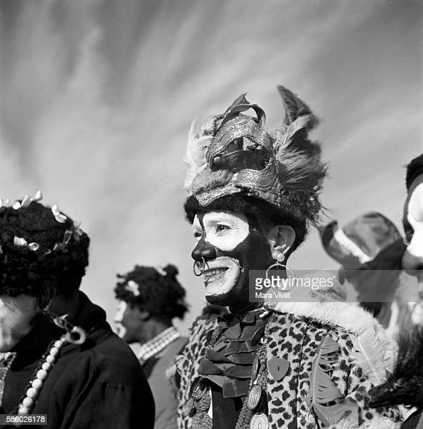 A man at a Mardi Gras event in blackface is dressed as an African tribesman New Orleans Louisiana