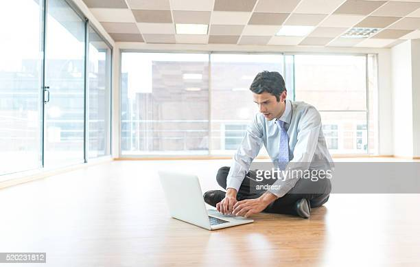 Man at a new office working on a laptop