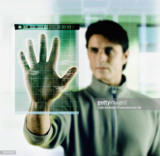 Man at a palm scanner