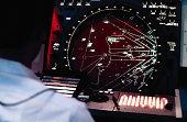 Man at air defense radar system monitor