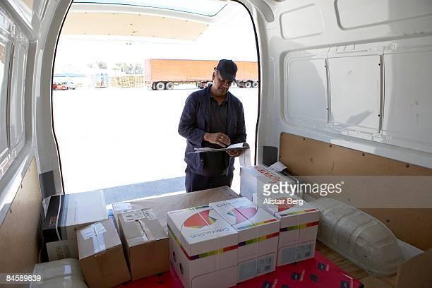 Man at back of van