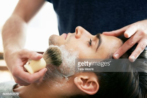 man at barber shop with shaving cream