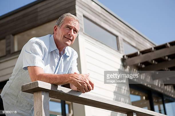 Man at beach house